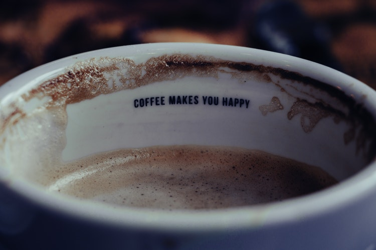 """coffee cup with """"coffee makes you happy"""" wrote inside"""